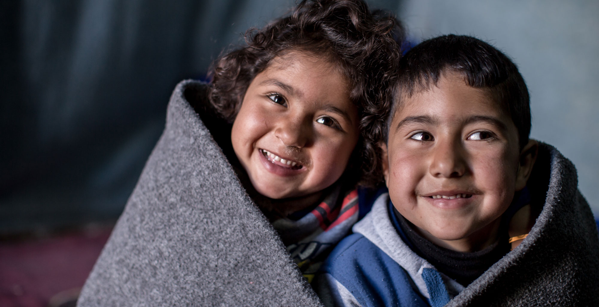 How can a blanket help Syrian children?